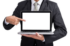 Yong businessman holding laptop computer showing screen display. Isolate on white background Stock Images