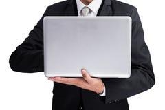 Yong businessman holding laptop Stock Image