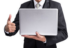 Yong businessman holding laptop Royalty Free Stock Photo