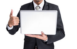 Yong businessman holding laptop Stock Photo