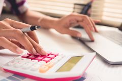 Yong businessmen calculate about cost for financial investment. Close up woman working at home office. yong businessmen calculate about cost for financial Stock Photo
