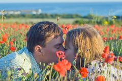 Yong couple with flowers near the sea. Stock Image