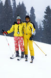 Yong Family Skiers And Snowfall Royalty Free Stock Images