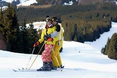 Yong family skiers on ski slope Royalty Free Stock Photos