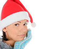 Yong female in santa hat over white Royalty Free Stock Photo