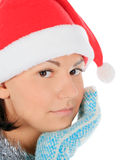 Yong female in santa hat over white Stock Photo