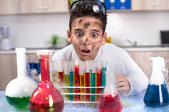 Yong funny scientist doing some crazy experiment. Boy doing experiments in the laboratory,Science and education concept Stock Images
