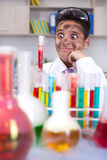 Yong funny scientist doing some crazy experiment royalty free stock images