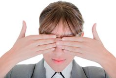 Yong girl in office clouses. Woman closes her eyes with his hands Stock Photo