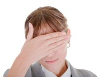 Yong girl in office clouses. Woman closes her eyes with his hands Stock Photography