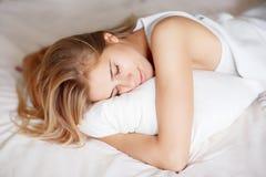 Yong girl sleeping Stock Image