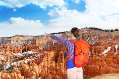 Yong hiker woman point to Bryce canyon Stock Image