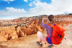 Yong hiker woman take picture of Bryce canyon Stock Image