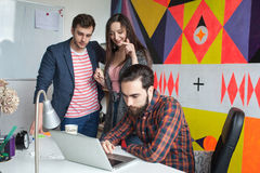Yong hipster team working in modern office Stock Photography