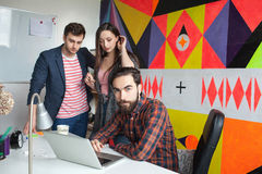 Yong hipster team working in modern office Stock Images