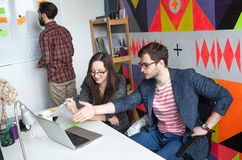 Yong hipster team working in modern office Royalty Free Stock Photos