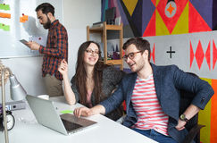 Yong hipster team working in modern office Stock Image