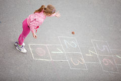 Yong little  girl on the hopscotch Stock Photo