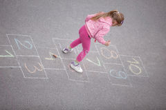Yong little  girl on the hopscotch Stock Images