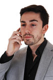 Yong man on cell phone. Royalty Free Stock Image