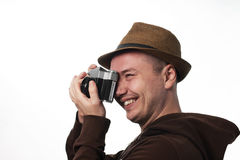 Yong man  holding photocamera Royalty Free Stock Photos