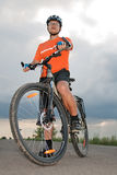 Yong man before starting bike. Looking forward Stock Photo