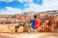 Yong man take picture of Bryce canyon with phone Stock Photography