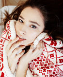 Yong pretty brunette girl in Christmas ornament blanket getting warm on cold winter, freshness beauty concept Royalty Free Stock Photos