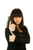Yong smiling girl with a gun Royalty Free Stock Photos