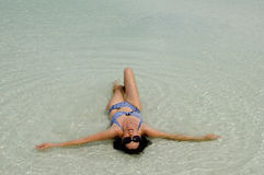 Yong woman bathing on Aitutaki Lagoon, Cook Islands. Royalty Free Stock Photo