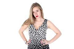 Yong woman in classic Retro Polka Dot Dress Stock Photo