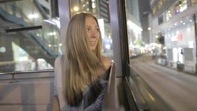 Yong Woman in een Tram stock footage