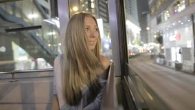 Yong Woman in einer Tram stock footage