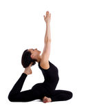 Yong woman exercise yoga  - pigeon pose isolated Stock Photography