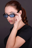 Yong woman holding glasses Royalty Free Stock Photo