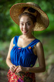 Yong woman off smile of silk dress asian woman in Laos.  Stock Photos