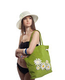 Yong woman portrait in straw hat with bag Royalty Free Stock Image