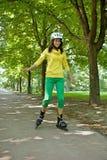 Yong woman riding roller skate Stock Photo