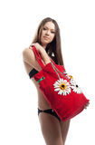 Yong woman show her red beach bag isolated Stock Photography