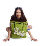 Yong woman sit with green beach bag smile isolated Royalty Free Stock Images