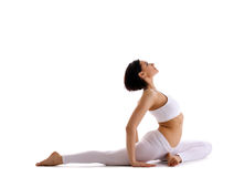 Yong woman sit in yoga asana - pigeon pose Royalty Free Stock Photography