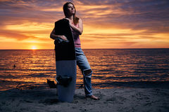 Yong woman standing on the shore with wakeboard Stock Photo