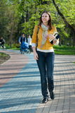 Yong woman walking in the park Stock Photos
