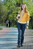 Yong woman walking in the park Stock Photography