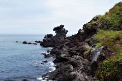 Yongduam Rock, Dragon Head Rock in Jeju, Korea stock photo