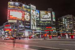 Yonge and Dundas square. Toronto, Canada - October 15, 2013: Yonge and Dundas square in Toronto at night, showing many colourful neon billboards with Stock Photos