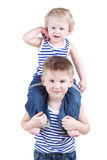 Yonger brother sits on shoulders of his brother Stock Photography