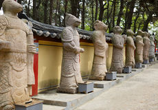 Yonggungsa Temple, Busan, South Korea. Alley with the twelve zodiacal figures of the Oriental horoscope Stock Images