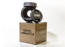 Yongnuo 50mm. Yongnuo lens of 50 mm with a diaphragm 1,8 high-aperture on a packing box Royalty Free Stock Images