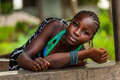 Yongoro, Sierra Leone, West Africa. Yongoro, Sierra Leone - June 04, 2013: West Africa, unknown girl in the village in front of the capital Freetown, SIerra Royalty Free Stock Images